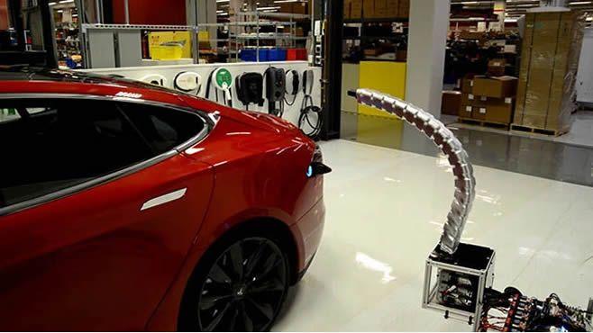 Photo of Increíble brazo cargador de auto Telsa